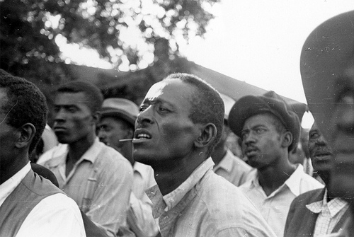 """""""Black men listening to a speaker at an outdoor STFU meeting"""" image by Flickr user Kheel Center"""